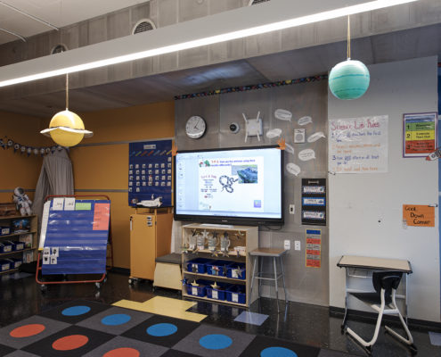 "each with a 70"" Promethean interactive display, a dedicated Mac Mini, and Elmo Document Camera."
