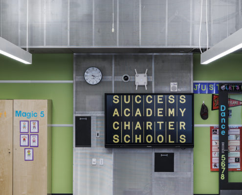"Forty-two classrooms, each with a 70"" Promethean interactive display, a dedicated Mac Mini, and Elmo Document Camera. Classrooms are also equipped with cameras and microphones for monitoring, in addition to a centralized paging system for emergency overrides of all classroom AV."