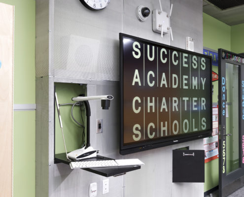 """Forty-two classrooms, each with a 70"""" Promethean interactive display, a dedicated Mac Mini, and Elmo Document Camera."""